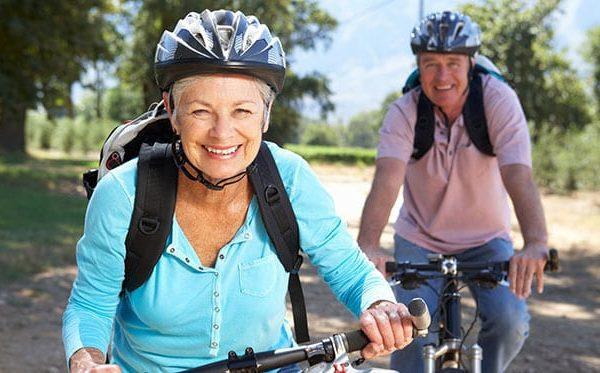 elderly couple riding bikes