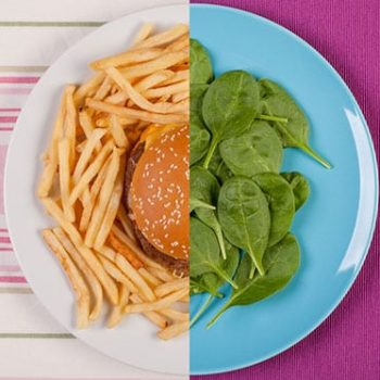 plate with salad and a hamburger